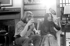 040571 19 (ndpa / s. lundeen, archivist) Tags: nick dewolf nickdewolf blackwhite monochrome blackandwhite 35mm film photographbynickdewolf bw april 1971 1970s boston massachusetts beaconhill familyhome 3mtvernonsquare people socialgathering livingroom fireplace mantle man woman youngman youngwoman couple youngcouple youngpeople longhair brunette glasses eyeglasses denimjacket girl unidentified everettcarlson facialhair beard glass cocktail shelves mask seated sitting chair easychair may