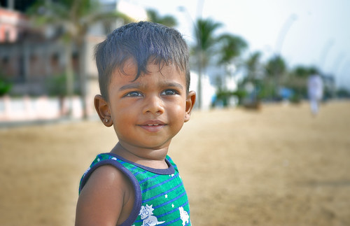 Smiling Indian baby boy on Beach