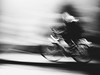 ghost rider (Sandy...J) Tags: olympus monochrom noir fotografie blackwhite bw blur blurred motion movement bewegung biker photography street streetphotography sw schwarzweis strasenfotografie urban verschwommen verwischt fahrrad art