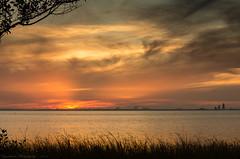 Sunset 1 (sugarhouse2) Tags: mobile bay alabama water dock docks sunset red glow clouds waves grass evening set sun sky