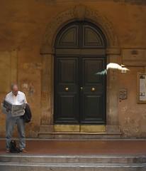 Man and door (Stephen Toye) Tags: man door doorway newspaper reading steps street streetphotography italy tuscany pisa leica leicax2 architecture masonry stonework coloursoftuscany yellowochre sunbeam