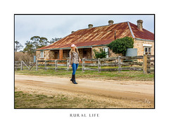 Rural Life, woman walking along dirt country road (sugarbellaleah) Tags: rural country outback road dirt female style woman person countrylife rurallife farmgirl jeans hat house abandoned old dilapidated fence blonde hair check shirt walking boots outdoors lifestyle australia thisisaustralia fashion cheeful smiling diversity multicultural cobblestone tinroof rusted sandstone