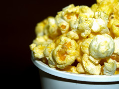 Popcorn background (www.icon0.com) Tags: snack popcorn food white corn delicious background cinema entertainment isolated nobody salty classic full macro movie tasty refreshment pop crunchy fresh yellow fastfood pack closeup fast bucket nutrition dessert texture
