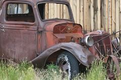 Fading Memory (Bill G Moore) Tags: truck rust old grill door frame fence wyoming canon grass