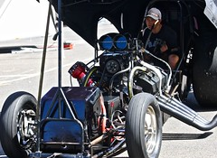 Riding High (*SIN CITY*) Tags: americancarsinaustralia drag race australia qld person funnycar topfueller willowbank willowbankraceway dragster v8 horsepower fast racer bw transport vehicle top fuel car racecar supercharged supercharger grunt power