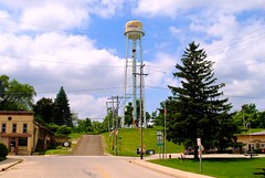 Lowell, Wisconsin Water Tower (Cragin Spring) Tags: wisconsin wi midwest smalltown sky cloud unitedstates usa unitedstatesofamerica rural lowellwi lowellwisconsin lowell dodgecounty watertower road street