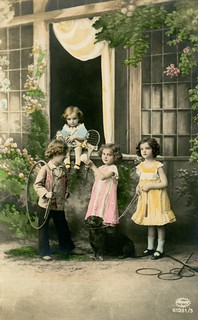 Children with Their Dog and Toys