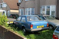 1987 Vauxhall Nova (doojohn701) Tags: rare vintage blue luton vauxhall nova opel kaddett vegetation houses windows uk saloon 1987 reflection alarm omega bmw twodoor wall pvc damage rearbelts pebbledash d51pkj bins dirt debris