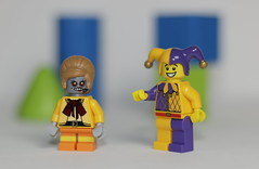 The Jester thinks the Lady Bot is pretty cool (N.the.Kudzu) Tags: tabletop lego minifigures ladybot jester wooden blocks canondslr primelens canon50mmf18