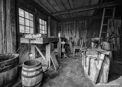 Tools of the Trade (mswan777) Tags: 1020mm sigma d5100 nikon vacation travel white black monochrome iron trade barrel bench wood history michigan mackinaw michilamackinac fort work detail shop metal tool