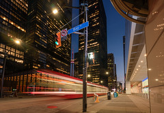 Down town Toronto (reinaroundtheglobe) Tags: toronto canada ontario downtown city road traffic tram longexposure financialdistrict nopeople architecture buildings cntower trafficlights crossing lighttrails night