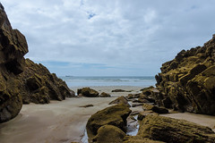 Druidston Haven (mikeplonk) Tags: pembrokeshire westwales wales stbridesbay rocks beach sea seascape druidstonhaven frame naturalframe framed sand nikon d5100 18140mm kitlens water