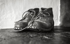 A story of a boy in the Alps (PeterThoeny) Tags: prättigau graubunden graubünden grisons switzerland alps swissalps shoes boots vintage vintageboots vintageshoes indoor monochrome blackandwhite sony a7 ii a7mii alpha7mii ilce7m2 fe2870mmf3556oss 1xp raw photomatix hdr qualityhdr qualityhdrphotography fav100 macro