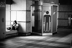 Female student reading - Jiantan MRT station, Taipei, Taiwan (BryonLippincott) Tags: websitegallery taipei taiwan taiwanese asia asian city urban mrt masstransit publictransportation lightrail station woman sitting alone reading quiet peaceful fashionable blackandwhite documentary candid student
