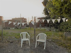 Future Park (navejo) Tags: montreal quebec canada future park chairs flags grass fence