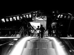 the light and dark... (Eggii) Tags: cinema manufaktura lodz blackandwhite monochrome black people mood evening
