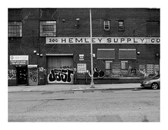 160515_1431_160515 114959_oly_S1_New York (A Is To B As B Is To C) Tags: aistobasbistoc usa newyorkstate newyork roadtrip travel olympus stylus1s monochrome bw blackwhite blackandwhite street streetart car wall graffiti hemleysupplyco door shutter warehouse brooklyn bushwick sidewalk pole window streetlight framed urban city eastwilliamsburg