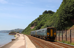 Teignmouth sea wall (Andrew Edkins) Tags: class153 class143 153382 143612 pacer dogbox teignmouth devon railwayphotography dmu passenger commuter travel trip seawall sea water geotagged canon light sun summer 2018 june