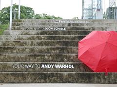 P1060106 (Elisabeth patchwork) Tags: lentos lentoskunstmuseum linz stairs gray red umbrella text