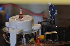Smoke Alarm's Burning (D-Rat) Tags: macromondays insideelectronics 7dwf fire littlepeople preiser nikon d800 sigma105mmmacro