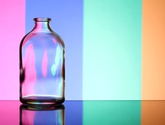 Pastels (Karen_Chappell) Tags: pastel blue pink green orange glass bottle vase stilllife refraction colourful colours colour color reflection