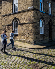 Saltaire 002 (Peter.Bartlett) Tags: women window unitedkingdom people corner doorway westyorkshire colour peterbartlett walking urban urbanarte candid uk m43 couple lunaphoto streetphotography backstreets sign microfourthirds olympuspenf facade shipley england gb