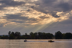 Under the rays of the setting sun (mariavolskaya) Tags: water clouds rays evening nikon sunset