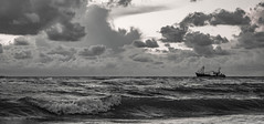 he never leaves me (Wöwwesch) Tags: blackwhite boat ocean waves sea clouds captain shrimps fishing sunset