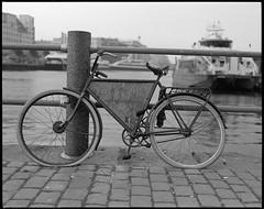 Bike & repairshop, say no more... (einarsoyland) Tags: hc110 kodak ilford fp5 fp5plus 1600 iso 400 pentax67 smcp6790mmf28 blackandwhite ishotfilm filmisnotdead developed kitchen bike bergen norway torget market bryggen repair flattire true2bw 6x7 negativfilm