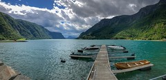 Boat Dock on the Sognefjord (briburt) Tags: skjolden zen calm peaceful view wideangle wide panorama iphonex beauty breathtaking green glacierwater dramatic dock clouds sun water landscape fjord iphone briburt norway boat lustrafjord sognefjord norwegian sunlight contrast cloudy pier glacial glacialwaters aqua