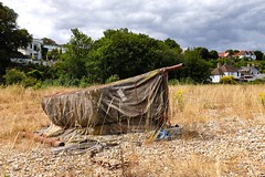 Cover Down (I Am Flakes) Tags: derelict abandoned old skyline house vegetation grass beach boat tarpaulin rope chain