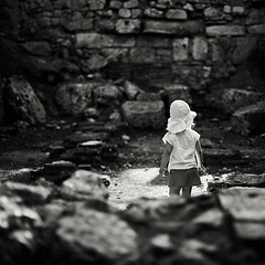 Exploring the Ruins. (icarium.imagery) Tags: canonef50mmf14usm canoneos6d child childportrait childphotography exploring explorer turkey phasalis ruins lykia blackandwhite bnw bw schwarzweiss oldstones archaeology phoenician dark girl light