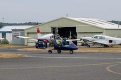 Cool pilot dude man (d0mokun) Tags: bobbington england unitedkingdom gb gcitx halfpenny green airfield ww2 aeroplanes airplanes planes autogyro cool pilot thumbs up