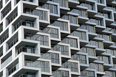 Stacked (Bad Kicker) Tags: building apartments glass symmetry architecture geometric lines shapes windows