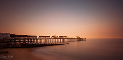 Southwold Pier [Explored]. (Simon Rich Photography) Tags: southward pier evening long exposure seascape landscape iconic sea coast coastling colours glow reflections still calm pastel nd110 simonrich simonrichphotography mrmonts canon sun sunset blue hour