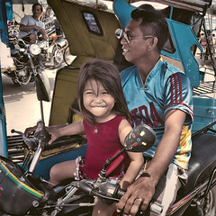 Young Driver (Artypixall) Tags: philippines cebu tricycles younggirl man driver sitting portrait desaturated urbanscene