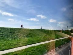 looking out (degeronimovincenzo) Tags: green lightblue outdoor bike embankment travel voyage bus sky polska poland kraków polonia cracovia
