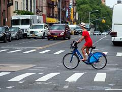 Traveling in style. (Will.Mak) Tags: red reddress heels bicycle manhattan newyorkcity newyork nyc nyclife streetphotography newyorkcitylife street bus cars chinatown lowereastside twobridges hat basket olympusem1markii olympusm75mmf18 olympus em1markii m75mm f18