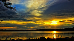 'Midas' Touches a Sunset (Explored 7/4/2018) (Bob's Digital Eye) Tags: bobsdigitaleye canon canonefs1855mmf3556isll clouds cloudscape flicker flickr golden goldenhour laquintaessenza lake lakesunsets lakescape may2018 reflections silhouette sky sunsetsoverwater t3i water sunset skyline