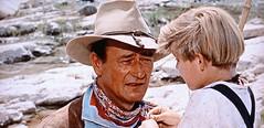 "Hondo wants to tell Johnny (Lee Aaker) who killed his father, but Angie persuades him not to.  ""Hondo"" (1953) (lhboudreau) Tags: movie film motionpicture western wildwest cowboy westernhero classicwestern warner warnerbros warnerbrothers 1953 color americanwest hat people screenshot johnwayne wayne hondolane hondo outdoor outdoors frontier americanfrontier actor moviestar arizona scarf lane louislamour johnfarrow halfbreed partindian boy child johnny johnnylowe leeaaker bloodbrother portrait theduke duke bandana"