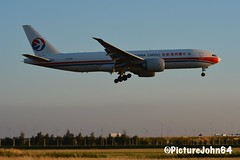 Triple7: CK217 China Cargo Airlines Boeing 777-200F (B-2083) arriving at sunset from Shanghai Pudong at Schiphol Amsterdam (PictureJohn64) Tags: vracht landing kaagbaan arrival d7100 nikon aeronauticas aerodrome vliegveld vliegtuig airplane airport aircraft picturejohn64 plane amsterdam schiphol sigma pudong shanghai 777 triple7 boeing airline cargo china ck217 b2083