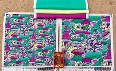 """Quirky Emerald Forest"", large and small scale fabric test swatches, with coordinating solids. My original design hand drawn by me digitally. (sassyone2013) Tags: woodland forest dragon nature tree trees fabric wallpaper giftwrap wrappingpaper sewing quilting crafting illustration drawing digitalart textile textiles purple yellow green animals bugs flowers birds squirrels snake cat cats anthropomorphic cartoon animation fantasyart whimsical purplefabric violetfabric dragons"