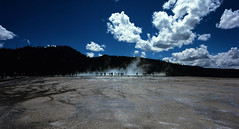 Grand Prismatic Silhouette  (Film) (Harald Philipp) Tags: outdoors rural panorama landscape natural scenic mountains hills holiday vacation tourism tourists exotic destination travel adventure wanderlust beautiful romantic mysterious silhouette velvia fuji 120film film analog analogue filmphotography mediumformat pentax645 unitedstates usa park nationalpark yellowstone grandprismaticspring prismatic steam geothermal volcanic geyser thermalpool clouds sky wyoming