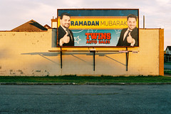 R1-056-26A (elsuperbob) Tags: dearborn michigan flanerie newtopographics billboard emptyspaces canona1 kodak portra400 kodakportra400 ramadan