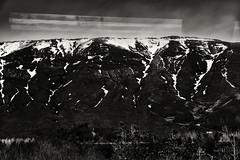 Depiction Of Light 4 (pni) Tags: monochrome through stg reflection cloud view landscape mountain hill fell tree snow sky frombuswindow is18 iceland ísland pekkanikrus skrubu pni laugarvatnsvegur road37