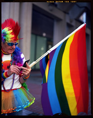 PrideSF: Rich Calls his Brother 180677 (jimhairphoto) Tags: sanfrancisco 2018 pride parade streetlife streetstories théâtrederue america remainsoftheday naturalworld 4x5project crown graphic camera mfg1963 4x5 kodak ektar film jimhairphoto