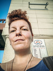 Anticipating (Melissa Maples) Tags: antalya turkey türkiye asia 土耳其 apple iphone iphonex cameraphone summer me melissa maples selfportrait woman brunette türkçe text sign busstop
