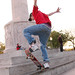 Robert Rivera demonstrates some skate moves at the base of the Logan Square monument (May 2003).
