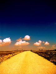 Path of Life (Ana Bel) Tags: road street blue sky cloud yellow spain warm path dirt pebble lonely infinite gravel instantfaves