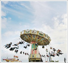 in colore. (tanjatiziana) Tags: carnival bw toronto swings cne midway theex canadiannationalexhibiton